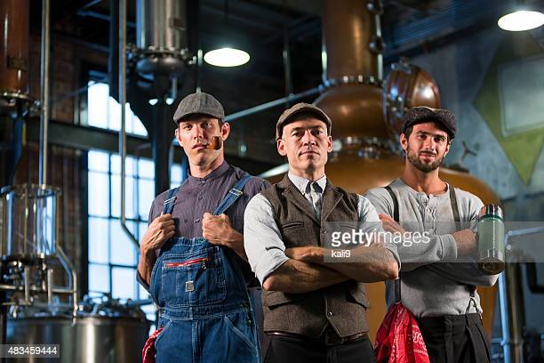Workers in an old distillery
