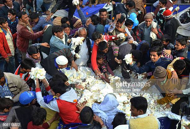 BSP workers in frenzy to get the cake during an event to celebrate the 60th birthday of their leader Mayawati at Ambedkar Park on January 15 2016 in...