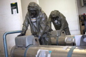 Workers in protective clothing check the cover of a dummy grenade during a press day at the GEKA facility on March 5 2014 in Munster Germany GEKA is...