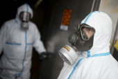 Workers in protective clothing stand at the door of a bunker during a press day at the GEKA facility on March 5 2014 in Munster Germany GEKA is...