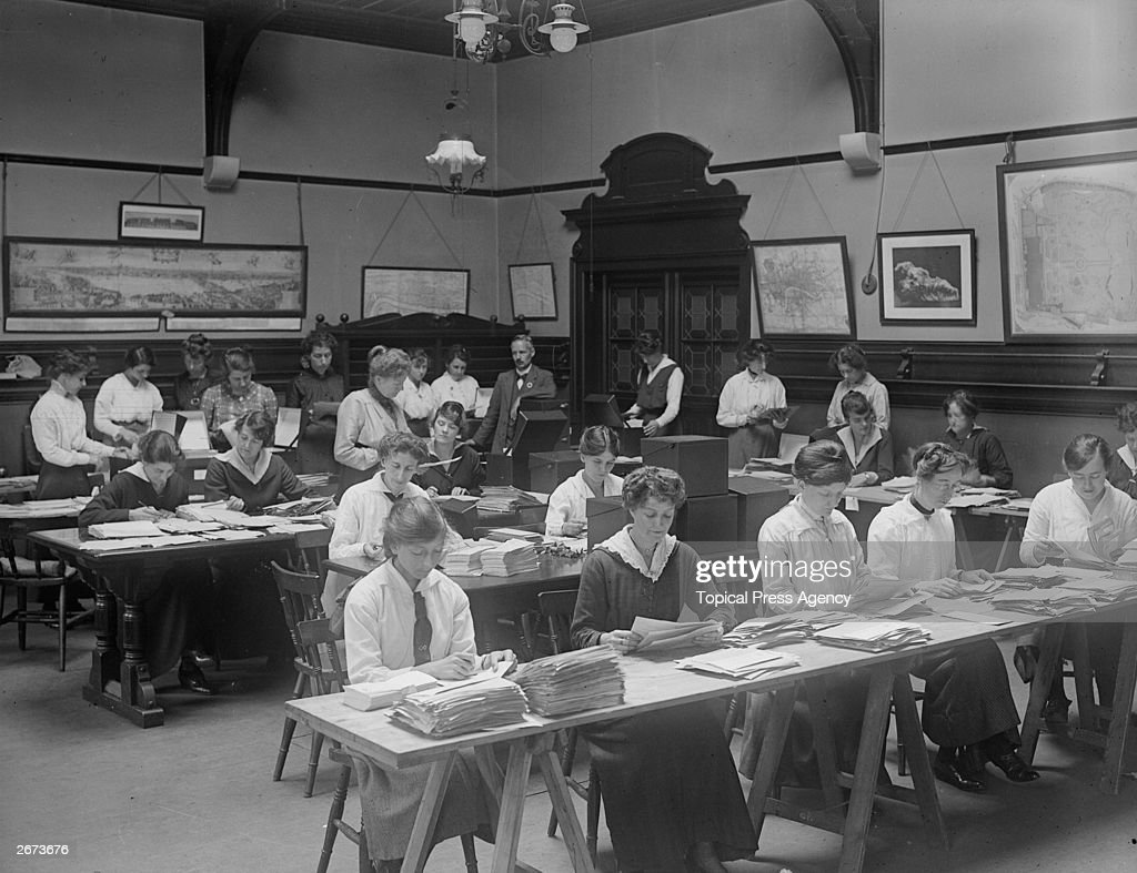 Workers in the British Food Control Office sorting sugar ration cards for distribution during World War I.