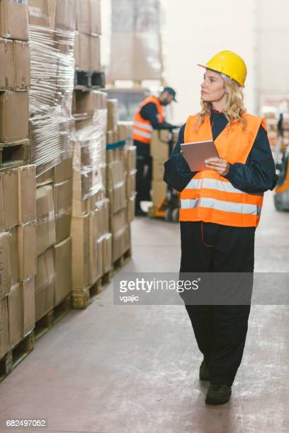 Workers in warehouse checking merchandise