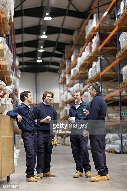 Workers in warehouse having break