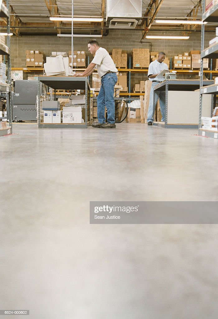Workers in Warehouse : Stock Photo