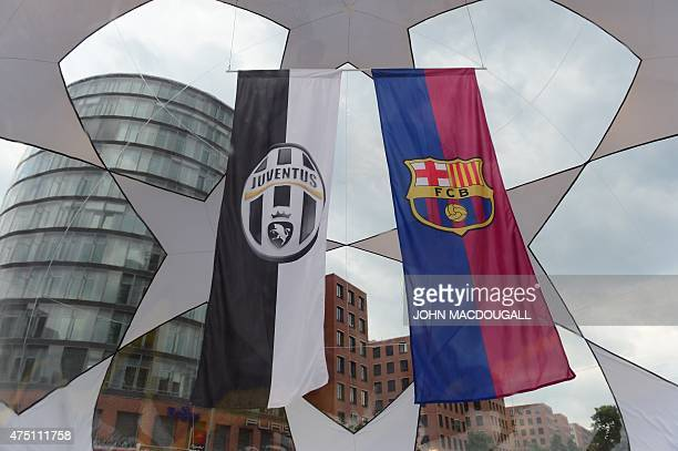Workers inflate a giant ball containing the banners of this year's UEFA Champions League finalists Juventus Torino and FC Barcelona at Berlin's...