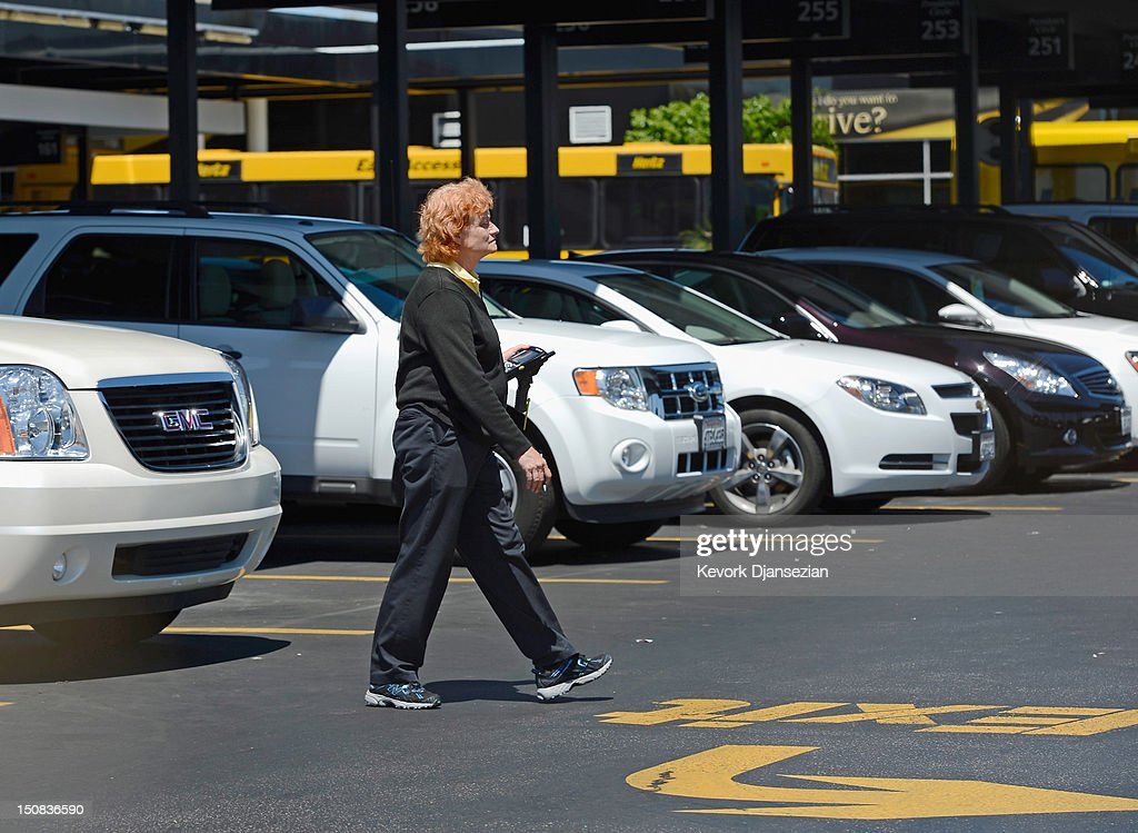 Workers inside Hertz Global Holdings car rental branch are seen August 27, 2012 in Los Angeles, California. Two major rental car companies agreed to merge as Hertz Global Holdings announced it is acquring Dollar Thrifty Automotive Group for $2.3 billion.