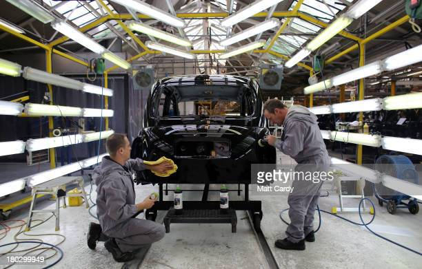 Workers inside the factory of The London Taxi Company polish a TX4 London Taxi on September 11 2013 in Coventry England The business secretary Vince...