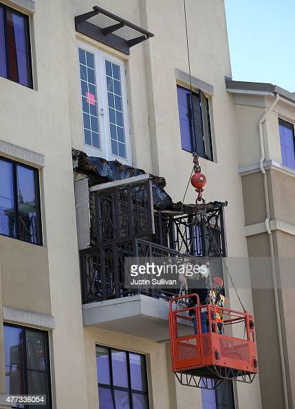 Workers inspect a balcony that collapsed at an apartment building near UC Berkeley on June 16 2015 in Berkeley California 6 people were killed and 7...