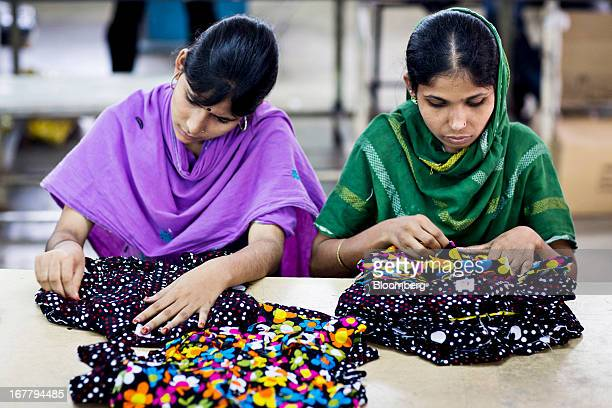 Workers inspect garments on the production line of the Fashion Enterprise garment factory in Dhaka Bangladesh on Monday April 29 2013 Bangladesh...