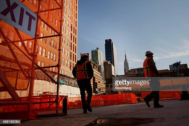 Workers inspect the completed Brookfield Office Properties Inc Manhattan West deck platform that covers the railroad tracks leading to Penn Station...