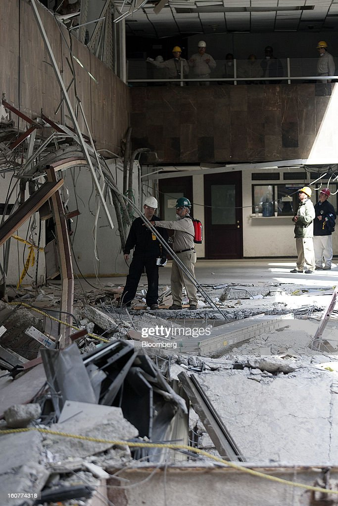 Workers inspect the explosion site at the Petroleos Mexicanos headquarters building in Mexico City, Mexico, on Tuesday, Feb. 5, 2013. Mexican authorities said a buildup of gas led to the blast last week that killed 37 people at Petroleos Mexicanos's headquarters, the first official attempt to explain the nation's deadliest explosion since 2006. Photographer: Susana Gonzalez/Bloomberg via Getty Images