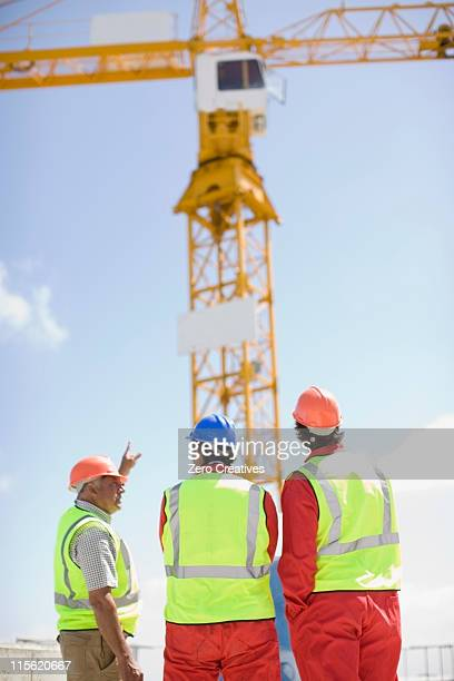 Workers inspecting a building plot