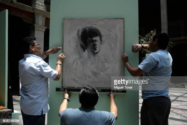 Workers install a painting of Jose Luis Cuevas before an homage to Mexican artist at Jose Luis Cuevas Museum on July 04 2017 in Mexico City Mexico...