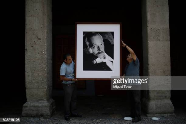 Workers install a portrait of Jose Luis Cuevas before an homage to Mexican artist at Jose Luis Cuevas Museum on July 04 2017 in Mexico City Mexico...
