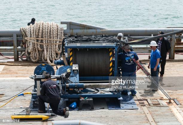 Workers install a sonar on the Argentine Navy Puerto Argentino vessel to take part in the search of the missing submarine ARA San Juan in Comodoro...