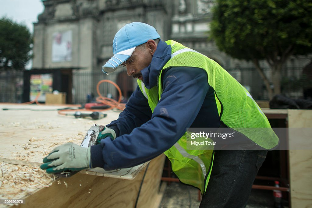 Workers install a wooden ramp at the entrance of the Catedral Metropolitana, as part of preparation ahead Pope Francis visit on February 10, 2016 in Mexico City, Mexico. The Zocalo main square is closed to public, as the perimeter is prepared for the upcoming visit of Pope Francis on February 12-17.