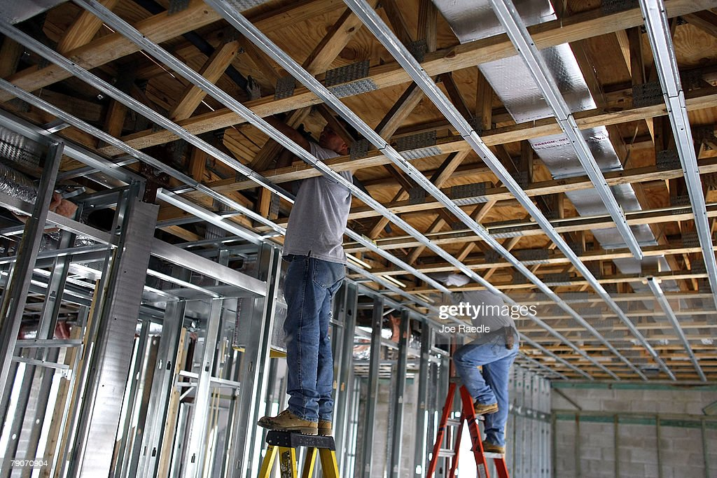 Workers install air conditioning inside a house under construction January 17, 2008 in Miami, Florida. The Commerce Department released figures showing that new home construction is down 24.8 percent from 2006.