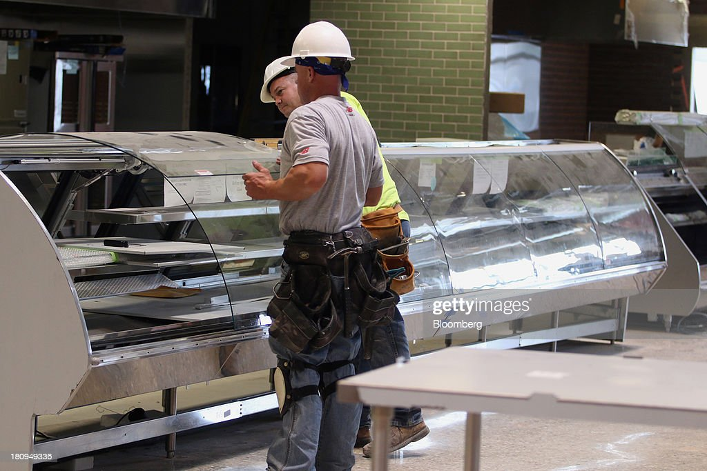 Workers install counters inside a new Whole Foods Market Inc. store under construction in Park Ridge, Illinois, U.S., on Tuesday, Sept. 17, 2013. Whole Foods is currently scheduled to open eleven new stores in the U.S. and 2 in the U.K by the fall 2014, according to its website. Photographer: Tim Boyle/Bloomberg via Getty Images