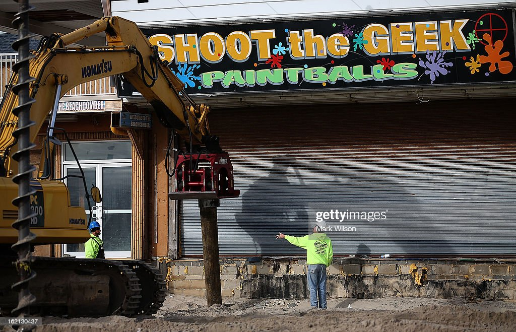 Workers install new pilings for the boardwalk that was damaged by Superstorm Sandy, February 19, 2013 in Seaside Heights, New Jersey. Governor Chris Christie has estimated that damage in New Jersey caused by Superstorm Sandy could reach $37 billion.