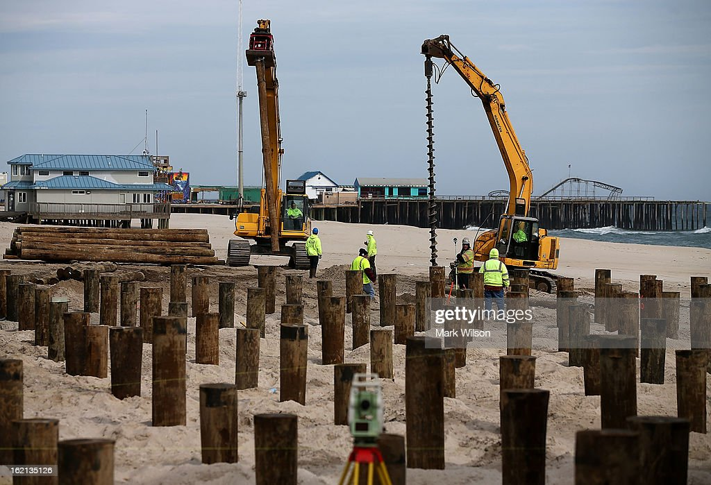 Workers install new pilings to replace the boardwalk that was damaged by Superstorm Sandy, February 19, 2013 in Seaside Heights, New Jersey. Governor Chris Christie has estimated that damage in New Jersey caused by Superstorm Sandy could reach $37 billion.