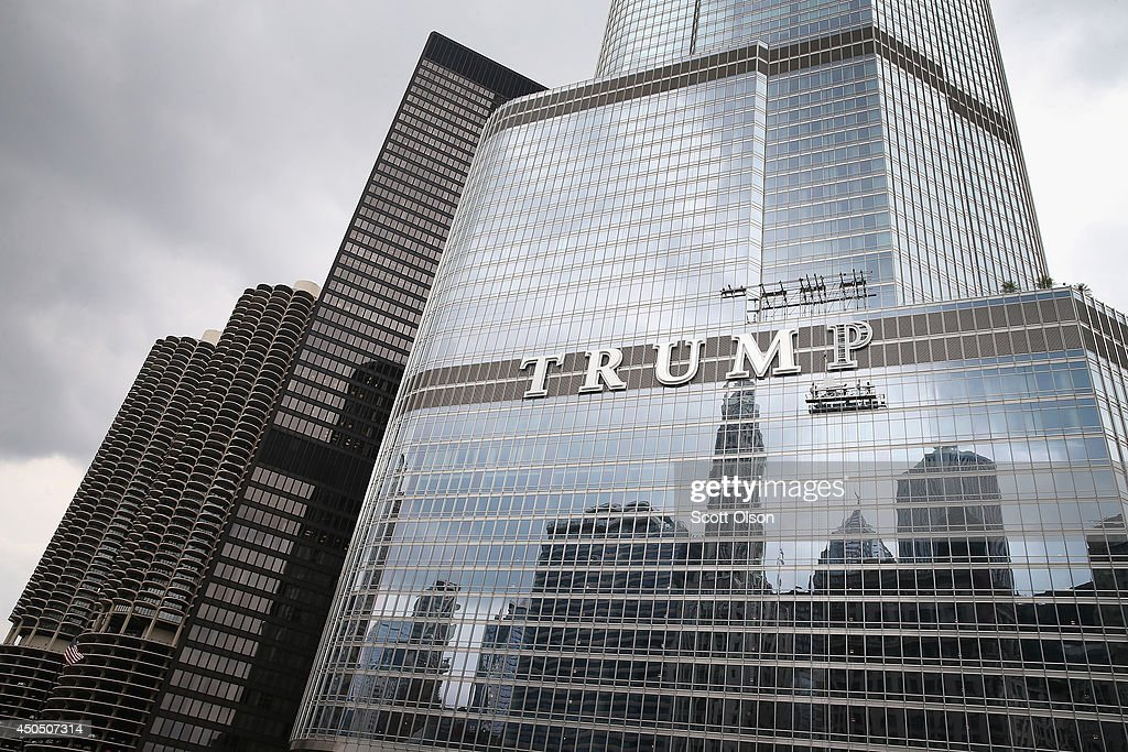 Workers install the final letter for a giant TRUMP sign on the outside of the Trump Tower on June 12, 2014 in Chicago, Illinois. Many in the city are opposed to the sign including Mayor Rahm Emanuel who has called it tacky and tasteless.