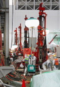 Workers install underground pipes to create frozen soil walls on the south side of the No 4 reactor building at the Fukushima Daiichi nuclear power...
