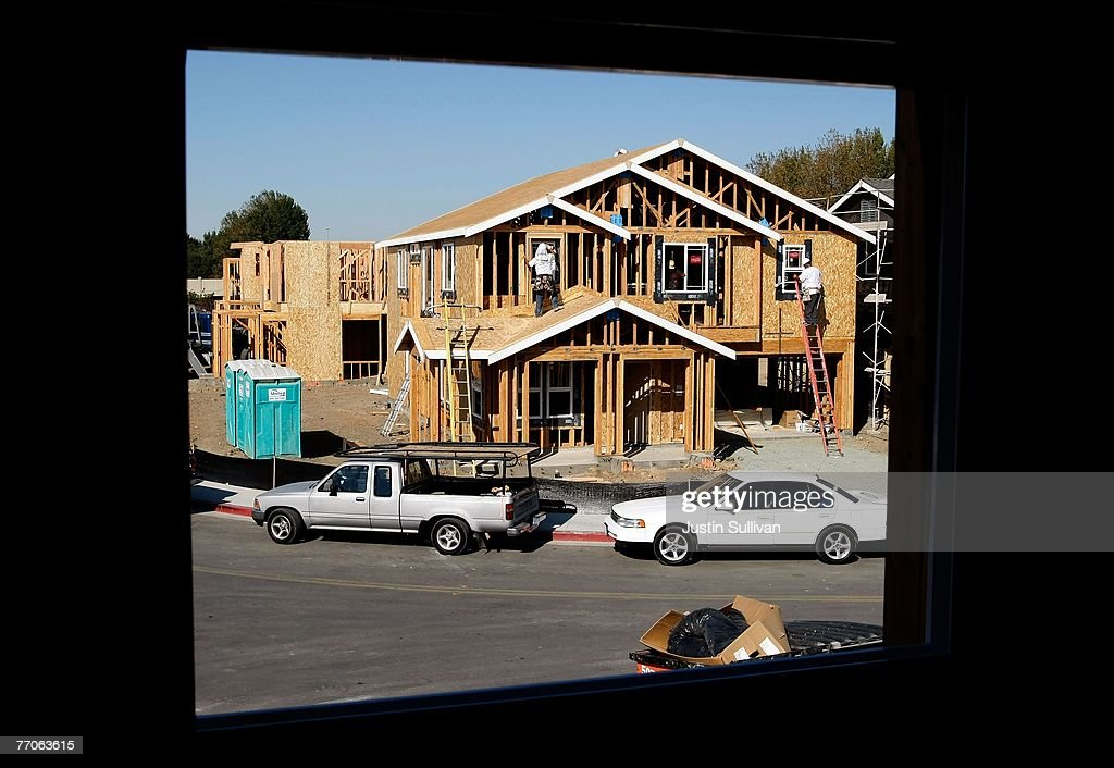 Workers install windows on a new home under construction at a housing development September 27, 2007 in Richmond, California.Tthe Commerce Department reported today that sales of new homes fell 8.3 percent in August, bringing sales to an annual rate of 795,000 units, the lowest level since June 2007.