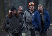 Workers involved in the rescue operation walk back to their vehicles in Donetsk on March 4 after a blast in the Zasyadko coal mine left at thirtytwo...