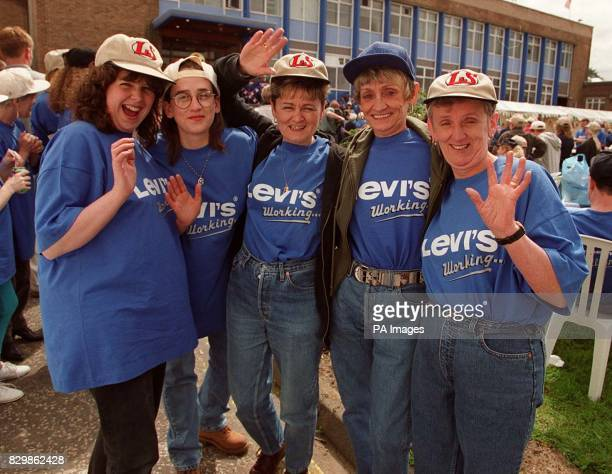 Workers Jane McElwane LeeAnne Reid Eileen Reid Elsie Jordan and Isobel Gavin from the Levi Strauss clothing factory in Whitburn Edinburgh celebrate...