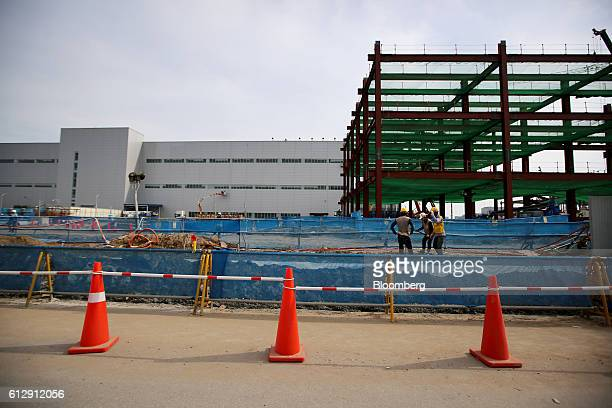 Workers labor at a construction site at the Samsung Electronics Vietnam Co Plant at Yen Phong Industrial Park in Bac Ninh Province Vietnam on...