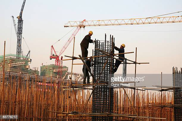 Workers labor at a construction site on November 21 2008 in Shanghai China The Shanghai government plans to invest 500 billion yuan in infrastructure...