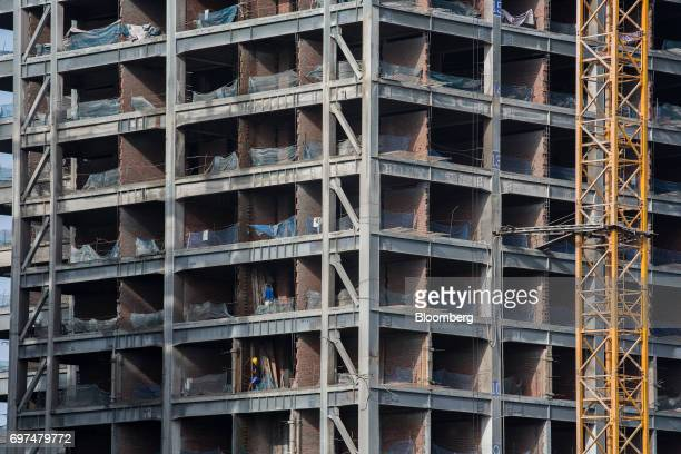 Workers labor at the construction site for the Kantharyar Center a mixeduse development that will also that will also house the Wyndham Grand Yangon...