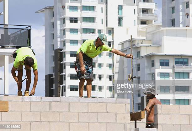 Workers labor on a construction site in Darwin Australia on Wednesday April 11 2012 Darwin is in the express lane of Australia's twospeed economy a...
