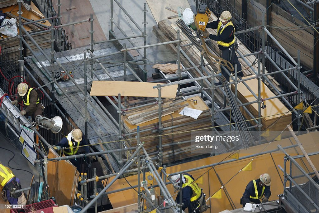 Workers labor on a construction site in Tokyo, Japan, on Thursday, Nov. 29, 2012. Japan's cabinet approved a second round of fiscal stimulus worth 880 billion yen ($10.7 billion) using budget reserves as Prime Minister Yoshihiko Noda attempts to boost the economy before elections on Dec. 16. Photographer: Kiyoshi Ota/Bloomberg via Getty Images