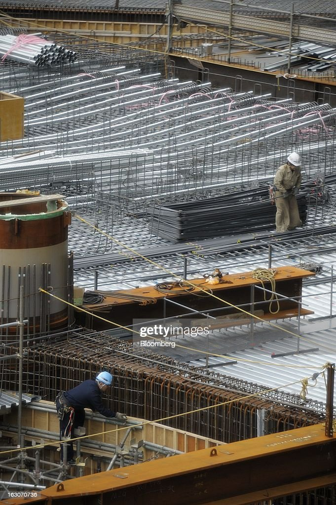 Workers labor on the construction site of Mori Building Co.'s Toranomon Hills development in Tokyo, Japan, on Friday, March 1, 2013. Mori Building Co., Japan's biggest closely held developer, said it plans to attract global companies to its new building set to open in 2014, its biggest project since Roppongi Hills opened a decade ago. Photographer: Akio Kon/Bloomberg via Getty Images