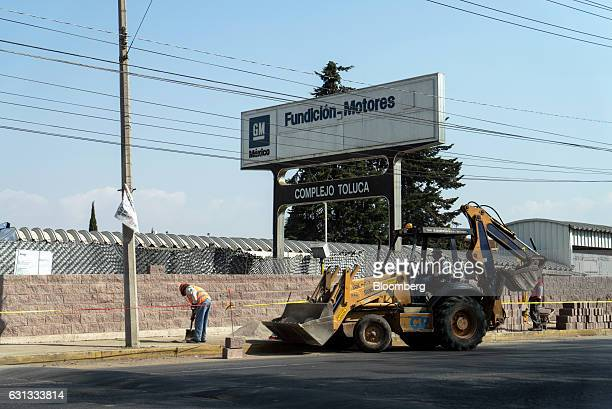 Workers lay bricks outside the General Motors Co assembly plant in Toluca de Lerdo Mexico on Saturday Jan 7 2017 Presidentelect Donald Trump slammed...
