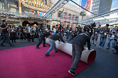 Workers lay carpet on Hollywood Boulevard during the ceremonial red carpet rollout in preparation for the 88th Annual Academy Awards at Hollywood...