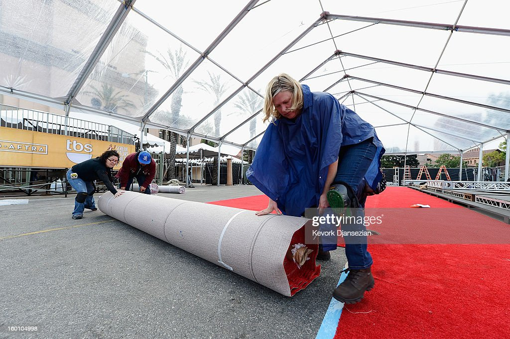 Workers lay down the red carpet during the 19th Annual Screen Actors Guild Awards red carpet roll out and presenter rehearsals at The Shrine Auditorium on January 26, 2013 in Los Angeles, California.