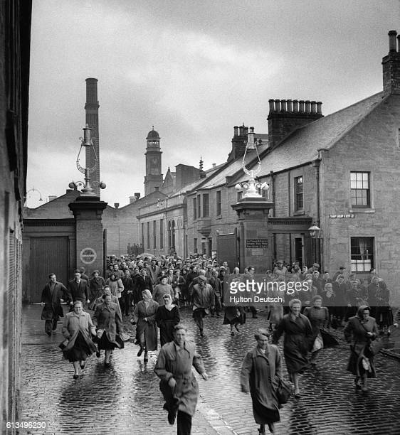 Workers leave the Campendown Mills in Dundee Scotland