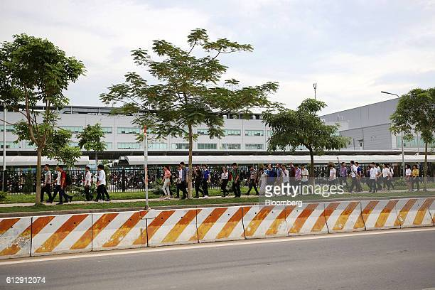 Workers leave the Samsung Electronics Vietnam Co Plant after finishing their shift at Yen Phong Industrial Park in Bac Ninh Province Vietnam on...
