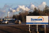 Workers leave the Suncor oil sands extraction facility near the town of Fort McMurray in Alberta Province Canada on October 25 2009 Greenpeace is...