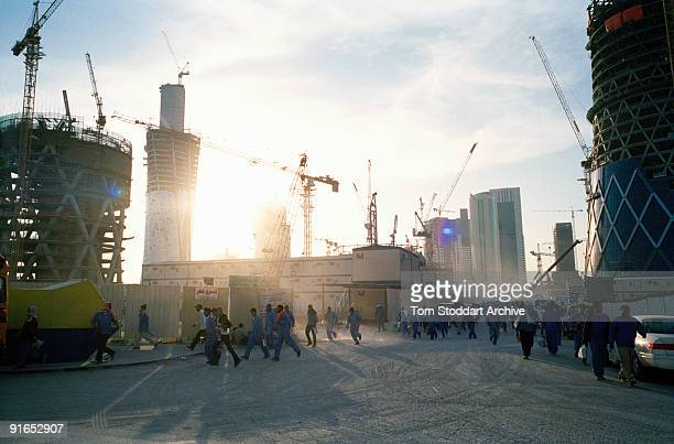 Workers leaving a construction site on the corniche in Doha Qatar May 2008