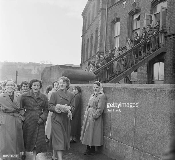 Workers leaving the Tillie and Henderson's shirt factory in Derry Northern Ireland November 1955 Original publication Picture Post 8199 One Man In...