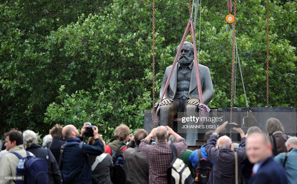 Workers lift a statue of German philosopher, political economist and sociologist Karl Marx off its base in Berlin on September 8, 2010. Two statues, Marx and German political philosopher Friedrich Engels are being moved, one by one to allow for work on the new U55 underground line. They were made by east German sculptor Ludwig Engelhardt and inaugurated in 1986 by then Communist supremo Erich Honecker.