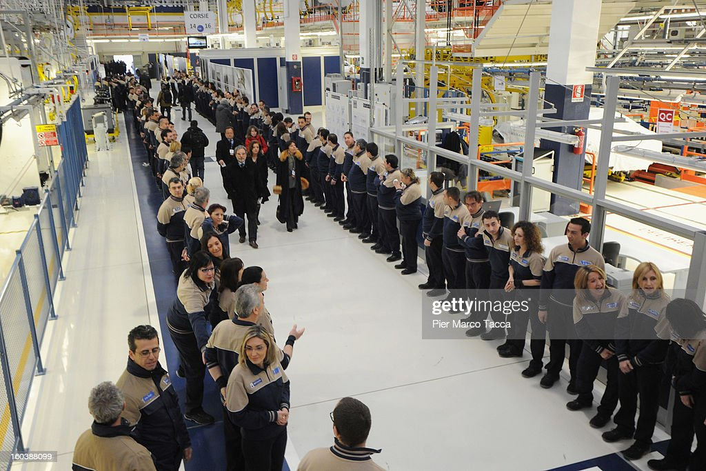 Workers line up as John Elkann And Sergio Marchionne attend the unveiling of the Maserati Plant in Grugliasco dedicated to Gianni Agnelli on January 30, 2013 in Turin, Italy. The new plant near the company's headquarters in Turin will produce Maserati's new model of luxury saloon cars, the Quattroporte.