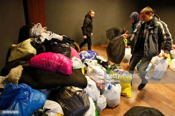 Workers load a humanitarian aid for Avdiivka inhabitants in the Point humanitarian aid in central KievUkraine 3 February 2017 Kievs residents donate...