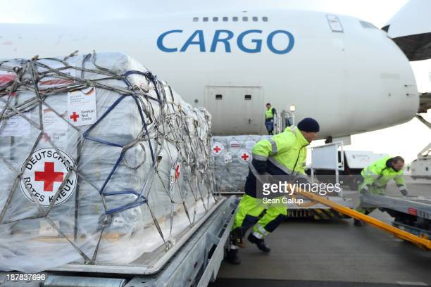 Workers load a shipment of aid from the German Red Cross destined for the Philippines on to a Boeing 747 cargo plane at Schoenefeld Airport on...