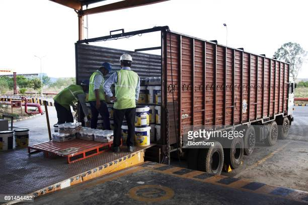 Workers load buckets of Dulux branded paint onto a truck at an Akzo Nobel India Ltd factory in Gwalior Madhya Pradesh India on Thursday June 1 2017...