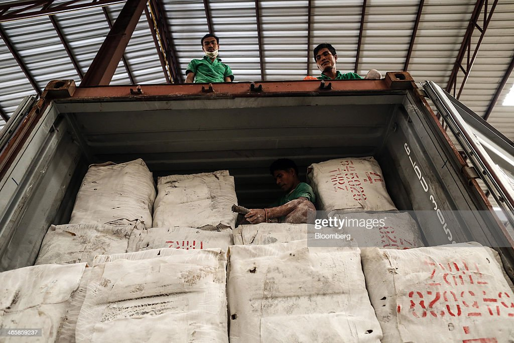 Workers load bundles of smoked rubber sheets onto a truck for shipment at the Thai Hua Rubber Pcl factory in Samnuktong, Rayong province, Thailand, on Wednesday, Jan. 29, 2014. Rubber production in Thailand, the world's largest exporter, may decline as growers from the main producing regions join protests seeking to overthrow the government, according to Von Bundit Co. Photographer: Dario Pignatelli/Bloomberg via Getty Images