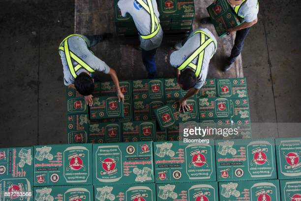 Workers load cases of Carabao energy drink onto a truck at the Carabao Group Pcl plant in Chachoengsao Chachoengsao Province Thailand on Saturday Dec...